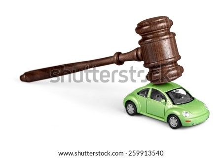 Gavel on car isolated on white background  - stock photo