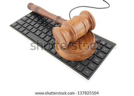 Gavel on computer keyboard isolated on white - stock photo