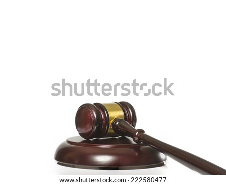 Gavel on wood block isolated against white background