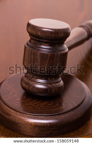 Gavel on wooden table vertical