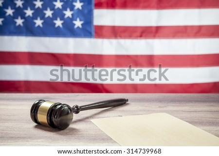 Gavel on Wooden tables, USA flag - stock photo
