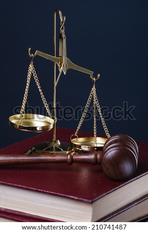 gavel, scale and books on blue