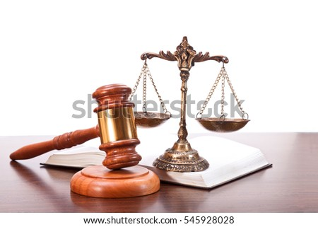 Gavel, scales and an open book on a white background