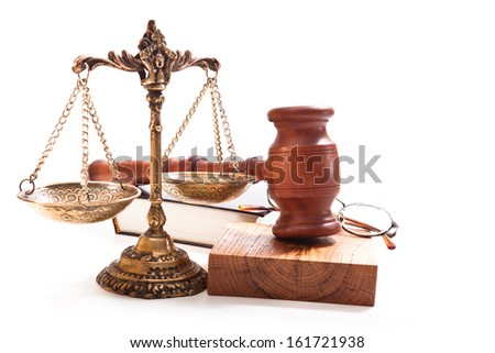 Gavel, scales, in a round-rimmed glasses and a book on a white background - stock photo