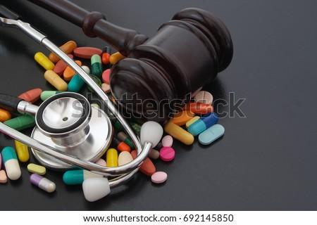 stock-photo-gavel-stethoscope-and-pills-