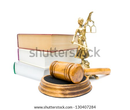 gavel, the statue of justice, and a stack of books isolated on white background. statue and the book is not in focus.