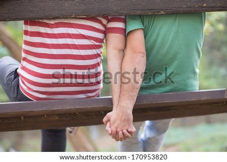 Gay couple enjoying autumn in the park - stock photo