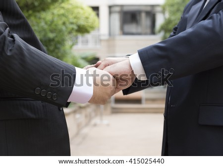 gay couple exchanging vow
