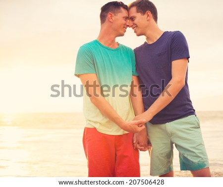 Gay couple on the beach at sunset - stock photo