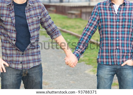 Gay Couple Outdise Holding Hands - stock photo