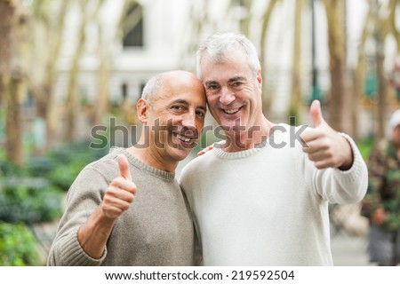 Gay Couple showing Thumbs Up in New York - stock photo