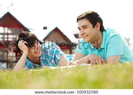 Gay couple spending summer vacation together in the country - stock photo