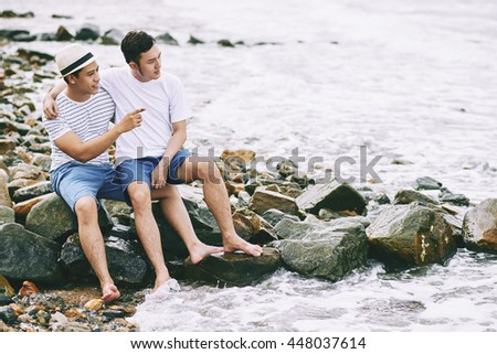 Gay couple spending time on the beach