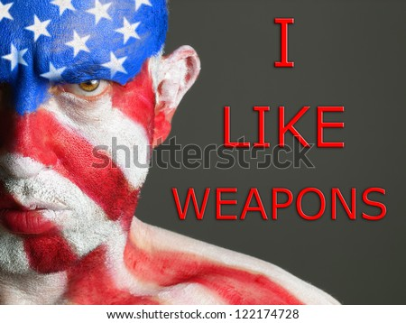 """Gay flag painted on the face of a man. Man is looking at camera and is smiling. The word """"pride"""" is write at one side. - stock photo"""