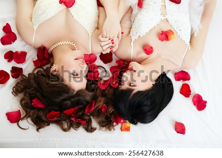 Gay marriage. Top view of smiling beautiful brides  - stock photo