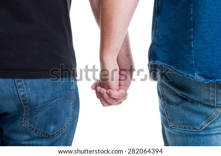 Gay men holding hands and wearing jeans. Lgbt freedom right concept - stock photo