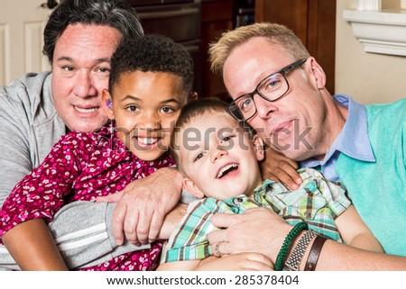 Gay parents and their children pose for a photo - stock photo