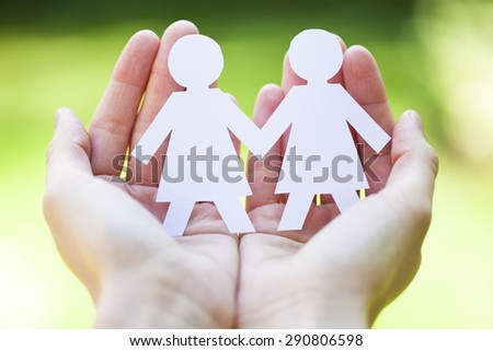 gay pride and love concept - close up of happy lesbian couple symbol in hands  - stock photo