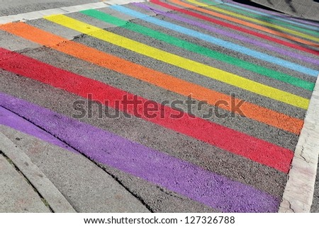 Gay Pride Crosswalk, Vancouver. Rainbow colors painted on a crosswalk for Gay Pride Week in Vancouver. British Columbia, Canada. - stock photo
