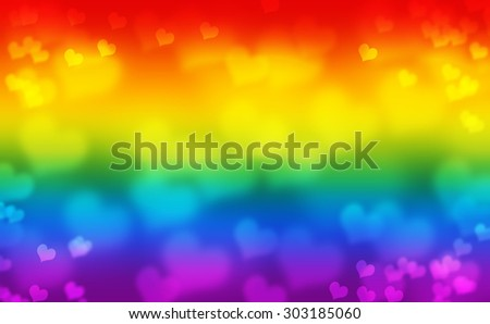 Gay Pride Flag. Gay Flag background. Defocused bokeh lights. Gay Pride hearts. Flag of Gay Pride movement with blurred heart. Illustration of LGBT Flag. Rainbow flag. - stock photo