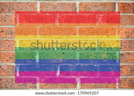 Gay pride flag painted on red brick wall