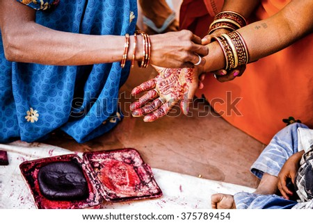 Traditional thai wedding ceremony family friends stock for Henna tattoo process