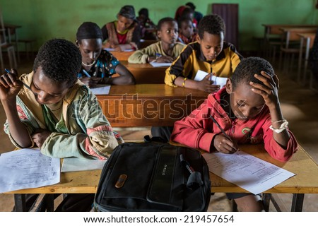 GAYO VILLAGE, ETHIOPIA - JUNE 20: Unidentified school boys take an exam in the village school on June 20, 2012 in Gayo village, Ethiopia.