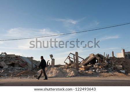 GAZA, PALESTINIAN TERRITORY - DECEMBER 2: A man walk nears rubble from Israeli bombings that destroyed a medical clinic and other structures in a community near Khan Yunis, Gaza, Dec. 2, 2012.