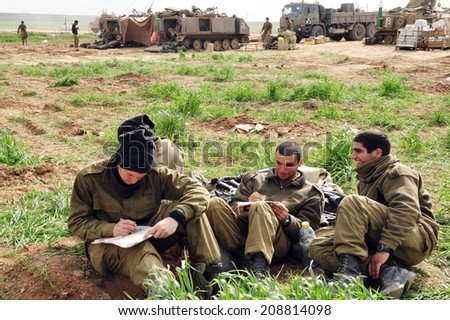 GAZA STRIP -JAN 17 2009:Israeli army soldiers are resting on the Jewish holiday of Shabbat during ceasefire with Hamas on Cast lead operation, Gaza War (2008�¢??09). - stock photo