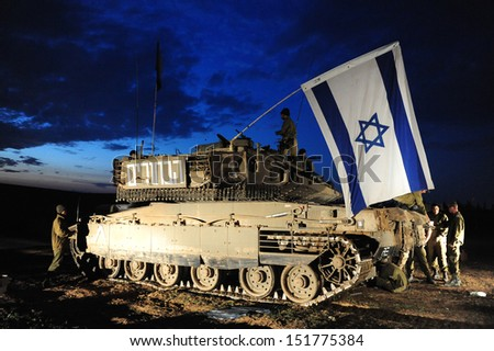 GAZA STRIP - JANUARY 16: The first Israeli troops leaving Gaza Strip after Cast Lead operation on January 16 2009. It was a three-week armed conflict in the Gaza Strip during the winter of 2008-2009. - stock photo