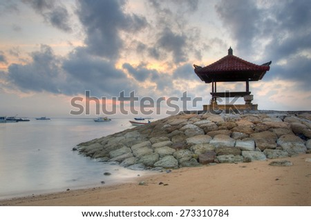 Gazebo on Sanur beach Bali in the morning - stock photo