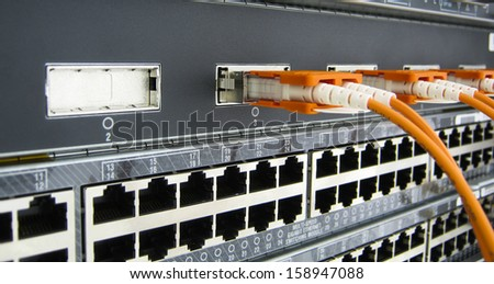 GBIC optic fiber communications switch equipment installed in large data center. - stock photo