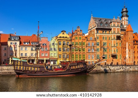 GDANSK, POLAND - APRIL 21, 2016: People at the quay port with many restaurants, view of Motlawa river in Gdansk. Old Town in Gdansk is a tourist attraction for visitors. - stock photo
