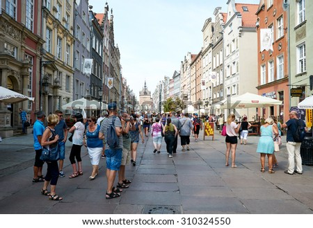 GDANSK, POLAND - AUGUST 12, 2015: People walking on streets in historical center of Gdansk - stock photo