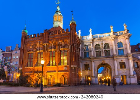GDANSK, POLAND - DECEMBER 17, 2014: Golden Gate to the old town of Gdansk at night, Poland. Baroque architecture of Gdansk is one of the most notable tourist attractions of the city. - stock photo