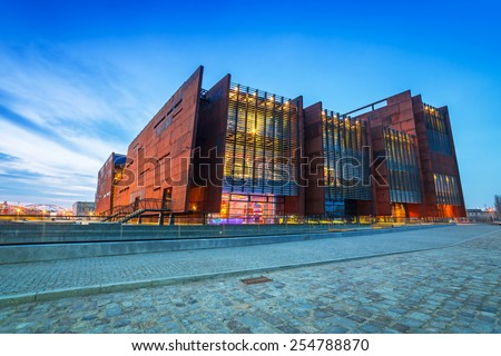 GDANSK, POLAND - FEBRUARY 21, 2015: Rusty steel building of European Solidarity Centre in Gdansk, Poland. The ECS museum located at the docyard is a memorial of anti-communist opposition in Poland. - stock photo