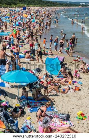 GDANSK, POLAND - JULY 19: Crowd on a Przymorze Beach during hot summer day on July 19, 2014 in Gdansk - stock photo