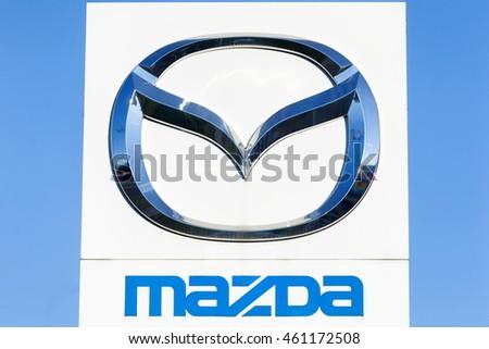 Gdansk, Poland - July 25, 2016: Logo of a japanese car manufacturer Mazda against a blue sky.