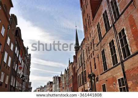 GDANSK, POLAND - JULY 14, 2013: Old pedestrian street with red brick houses against the blue sky.