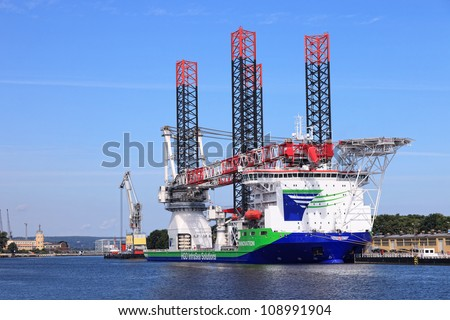 "GDANSK, POLAND-JULY 31: Specialist ship ""Innovation"" with a heavy crane system for building and operating offshore wind farms. Can carry cargo weighing up to 1500 tons. July 31, 2012 in Gdansk, Poland"