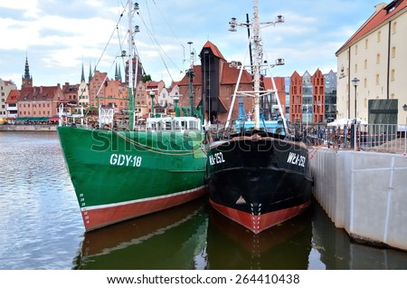 GDANSK, POLAND - May 17, 2014: Boats in historic marine. Ships at the Harbor of Motlawa river with old town of Gdansk, Poland.