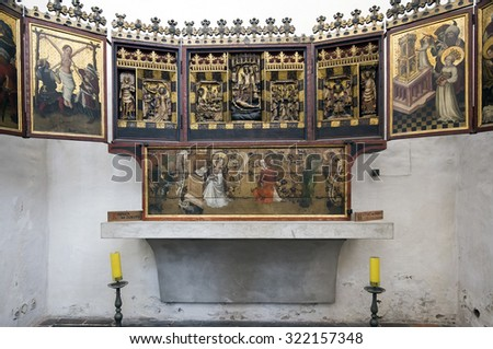GDANSK, POLAND - SEPTEMBER 20, 2015: Medieval altar in Basilica of Assumption of Blessed Virgin Mary,  Roman Catholic church in Gdansk, Poland, and is currently the largest brick church in the world.