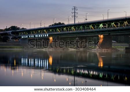Gdanski bridge in Warsaw, Poland during dusk time - stock photo