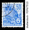 "GDR - CIRCA 1955: A stamp printed in GDR (German Democratic Republic - East Germany) shows a Ocean-going ship on stack without inscription from the series ""Workers For The Five-year Plan"", circa 1955 - stock photo"