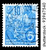 "GDR - CIRCA 1955: A stamp printed in GDR (German Democratic Republic - East Germany) shows Farmer, artisan, intellectuals w/o inscription, from the series ""Workers For The Five-year Plan"", circa 1955 - stock photo"
