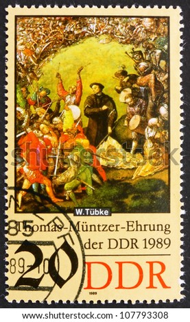 GDR - CIRCA 1989: a stamp printed in GDR shows Battle Scene, Detail of the Painting Early Bourgeois Revolution in Germany in 1525 by Werner Tubke, circa 1989 - stock photo