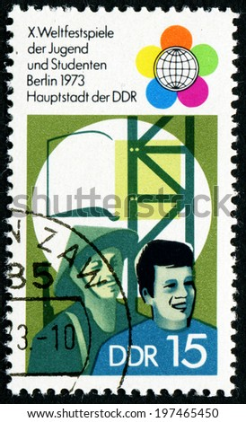 GDR - CIRCA 1973: a stamp printed in GDR shows Festival Emblem, Fireworks, TV Tower, World Clock, 10th Festival of Youths and Students, Berlin, circa 1973 - stock photo