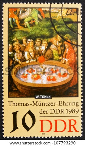 GDR - CIRCA 1989: a stamp printed in GDR shows Fountain, Detail of the Painting Early Bourgeois Revolution in Germany in 1525 by Werner Tubke, circa 1989 - stock photo
