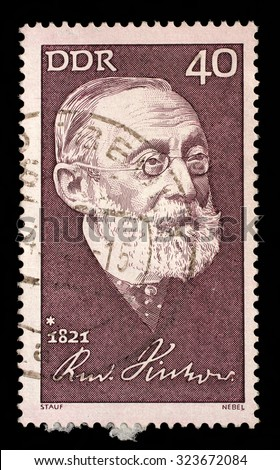 GDR - CIRCA 1971: A stamp printed in GDR shows The 150th Anniversary of the Birth of Rudolf Virchow. Anthropologist , circa 1971 - stock photo
