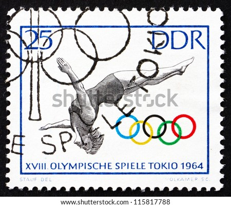 GDR - CIRCA 1964: A stamp printed in GDR shows Woman Diver, 18th Olympic Games, Tokyo 64, circa 1964